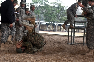 Soldiers, Sailors, Marines and Airmen practice Parachute Landing Falls on the Lateral Drift Trainer.